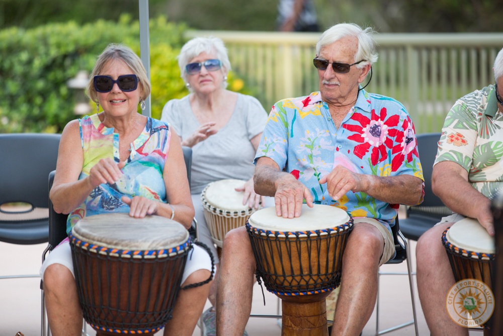 Attendees playing the bongos
