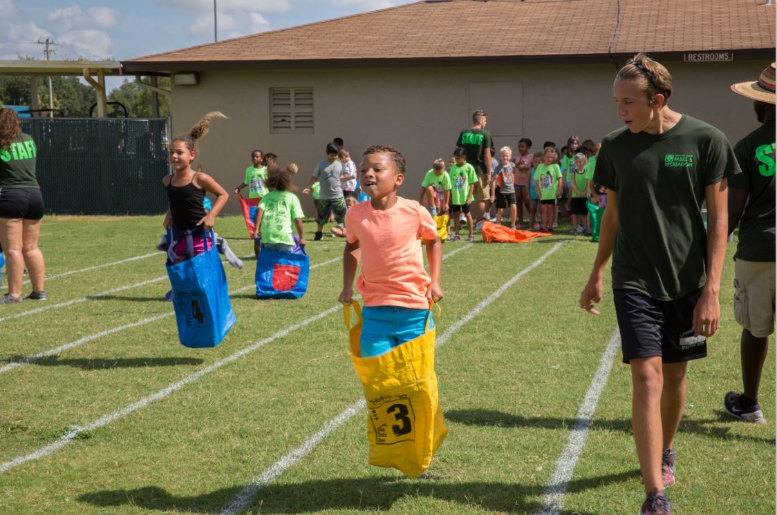 Camper participating in potato sack race