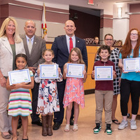 five student drop savers winners holding certificates