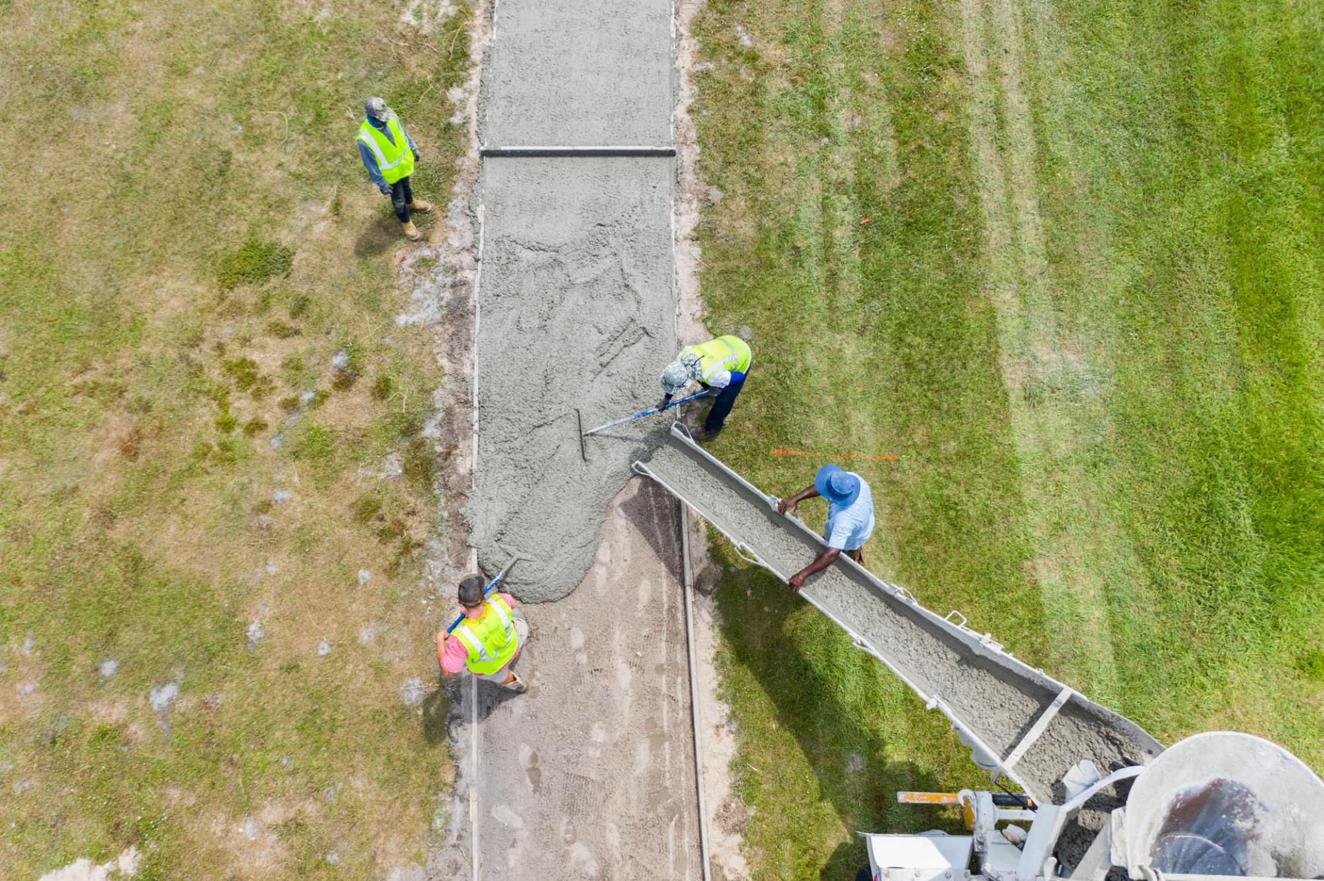 Aerial of staff pouring cement