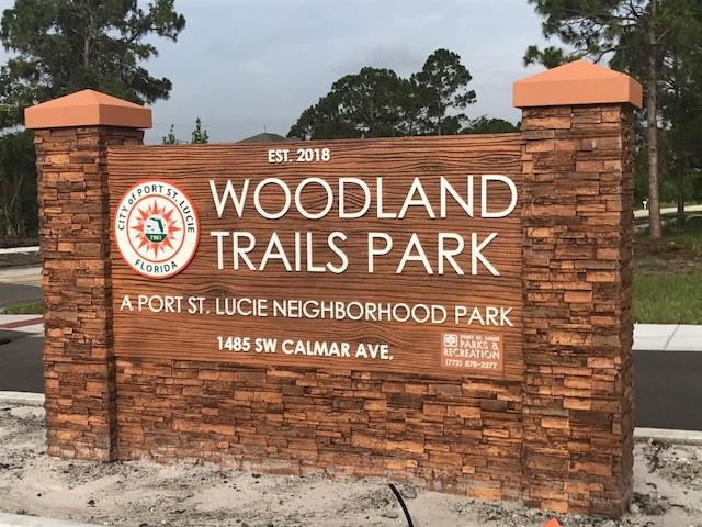 sign for woodland trails park