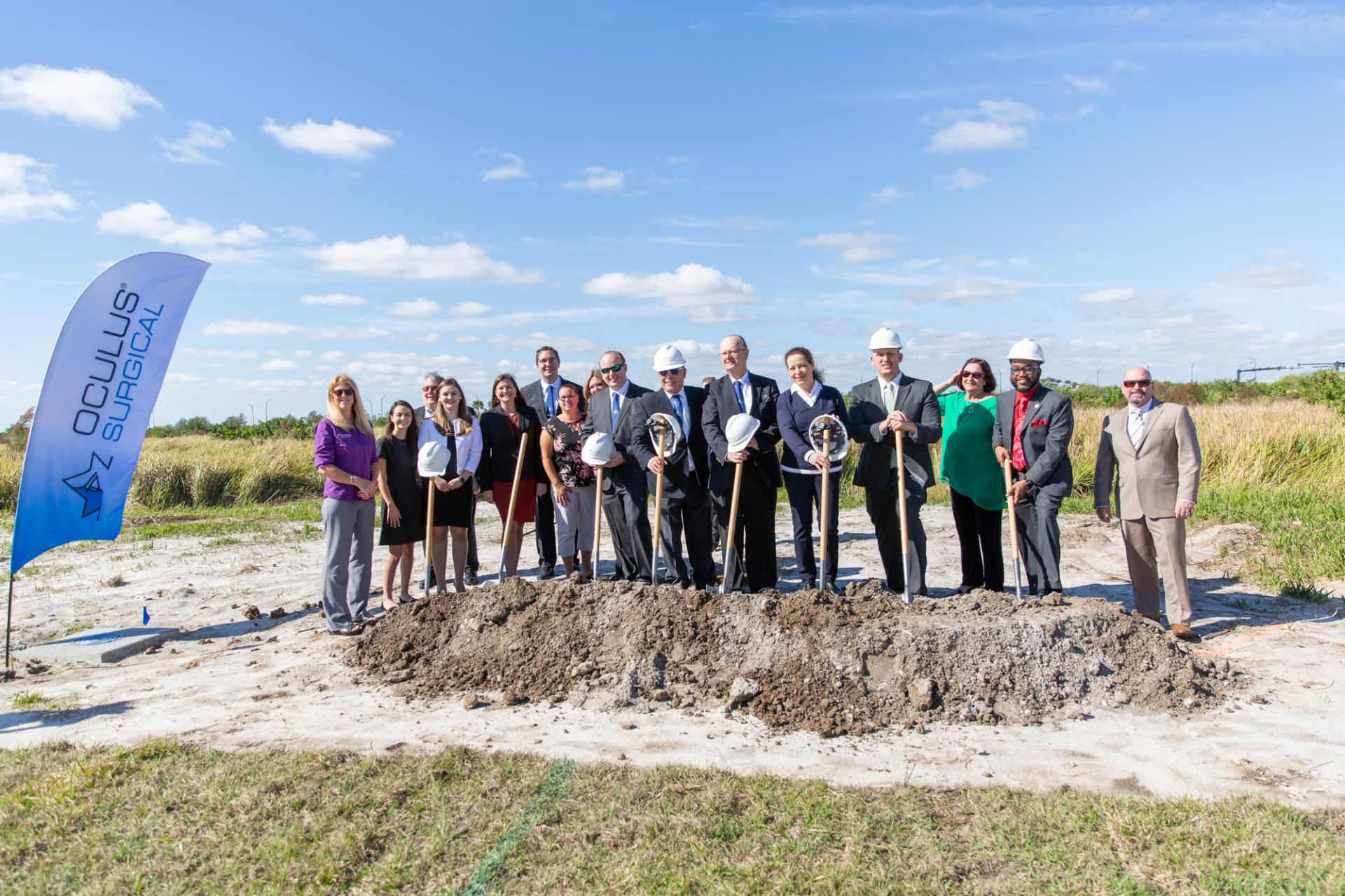 City county Oculus teams outside with shovels in ground
