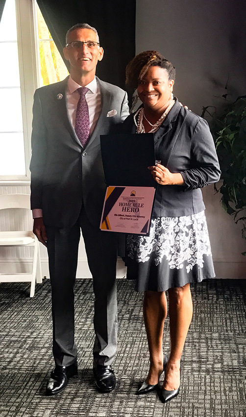 ella gilbert holding award from Florida League of Cities
