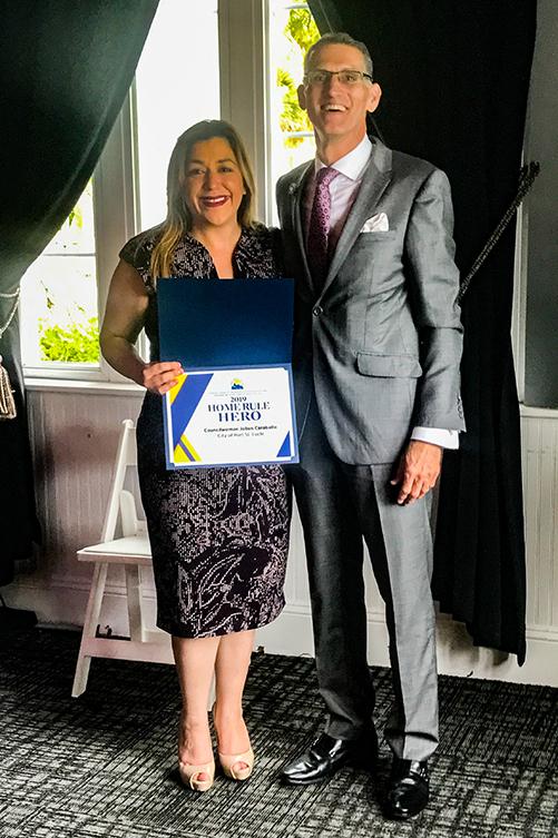 Jolien Caraballo holding award from Florida League of Cities